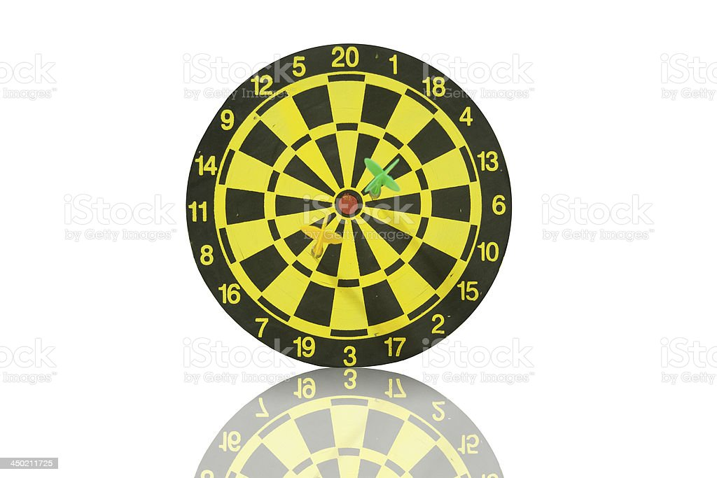 The dartboard with yellow and green dart. royalty-free stock photo