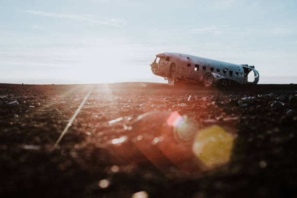 The DC-3 Plane wreck in Iceland The famous DC-3 plane wreck in Iceland on a black sand beach at sunset sólheimasandur stock pictures, royalty-free photos & images