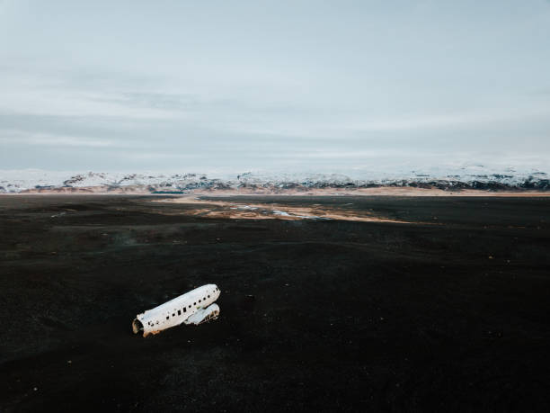 The DC-3 Plane wreck in Iceland The famous DC-3 plane wreck in Iceland on a black sand beach, shot with a drone sólheimasandur stock pictures, royalty-free photos & images