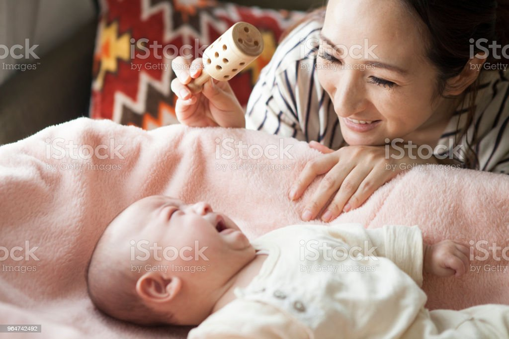 The dead baby is being toured with a toy. royalty-free stock photo