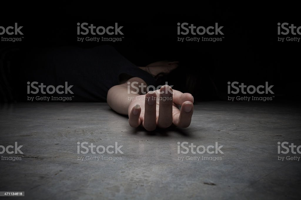 The dead woman's body. Focus on hand stock photo
