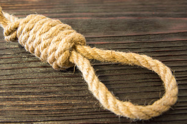 the deadly loop of rope. last seconds of life. unrequited love. - noose stock photos and pictures