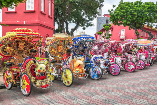 The decorated trishaws are parking in Dutch Square Malacca.Malacca has been listed as a UNESCO World Heritage Site since 7 July 2008. stock photo