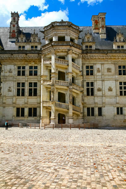 The decorative staircase of Blois Castle is seen from the side of the courtyard