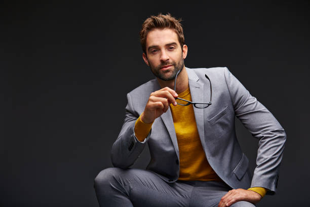the definition of dapper - menswear stock photos and pictures
