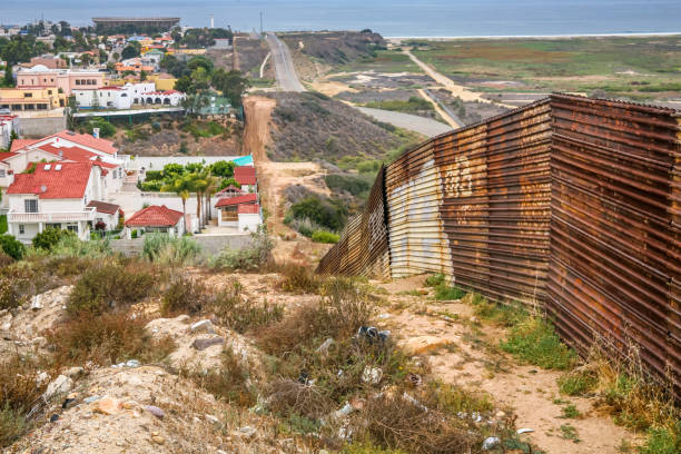 USA/Mexico Border - The Wall Tijuana, Mexico, Jul 07 - A view from the Mexican side of the steel wall on the border between the United States and Mexico on the Pacific coast of Playas de Tijuana. In the background the Imperial Beach in US territory. foreign affairs stock pictures, royalty-free photos & images