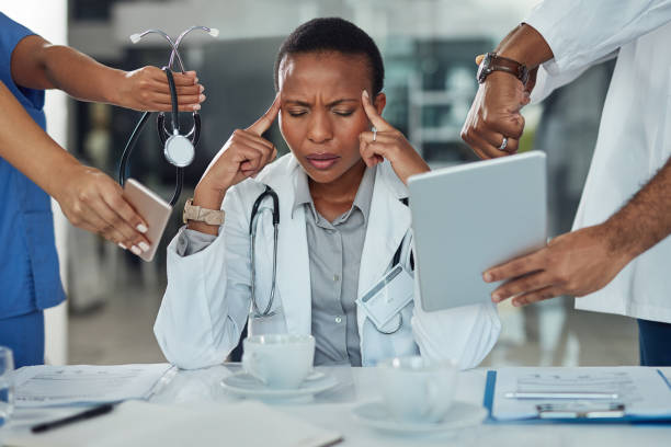 The demands of the day are getting to her Shot of a doctor looking stressed out in a demanding work environment mental burnout stock pictures, royalty-free photos & images