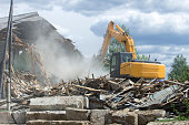 The demolition of the old wooden house