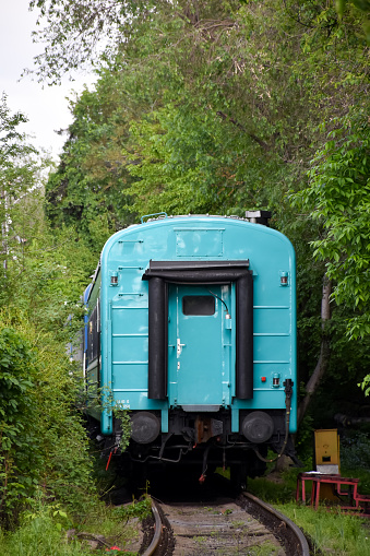 The departing train, the last blue car of the outgoing train from the railway station