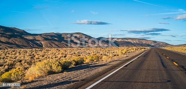 The road in the Nevada's desert at sunset