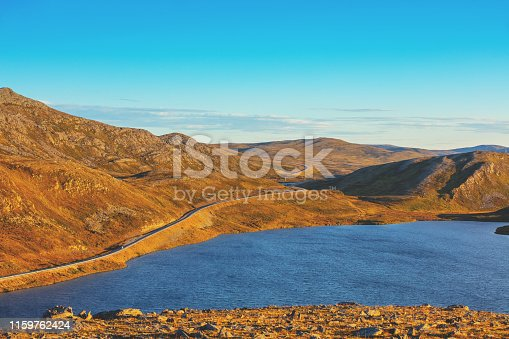 The deserted landscape of Mageroya island. Beautiful mountain lake. Wild nature of Norway