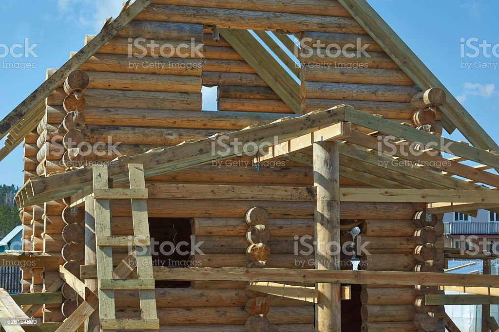 The design of a log home under construction. stock photo