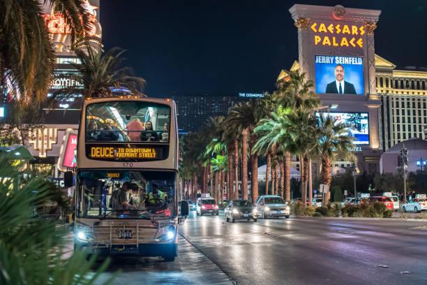 The Deuce bus at night  in Las Vegas stock photo