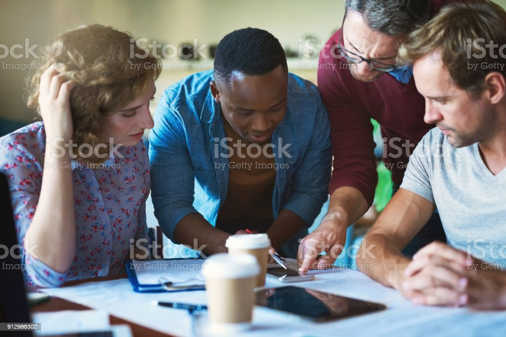 The development of a brand new app Shot of a diverse group of businesspeople collaborating on a project in a modern office Adult Stock Photo