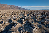 The Devil's Golf Course is a large salt pan on the floor of Badwater Basin located in the Mojave Desert within Death Valley National Park, California, USA. It was named after a line in the 1934 National Park Service guide book to Death Valley which stated that \