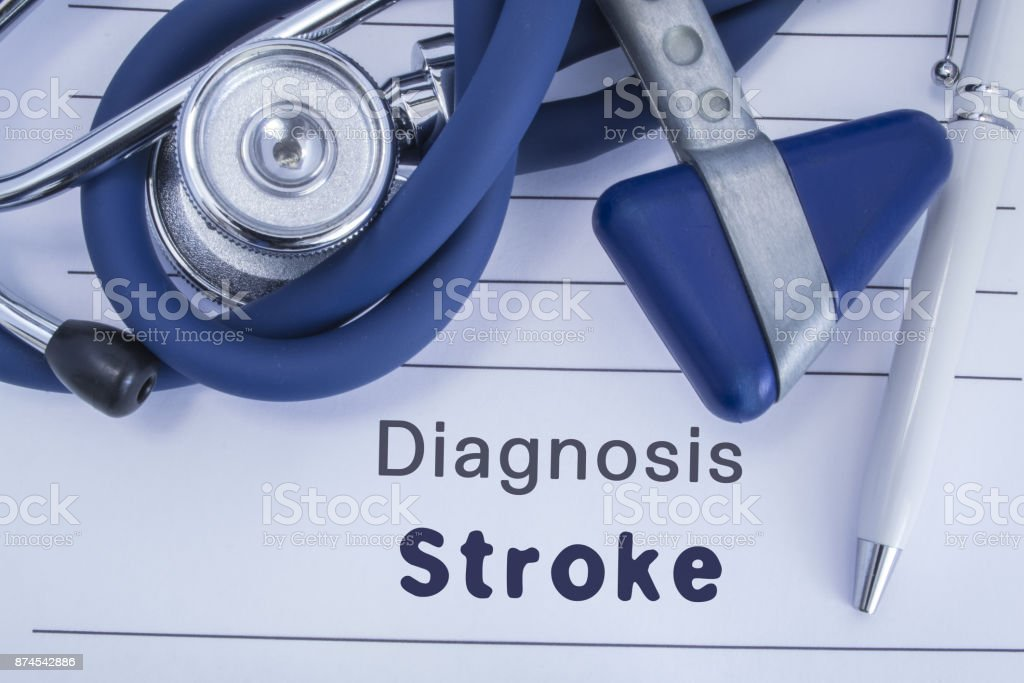 The diagnosis of stroke. Paper medical history with diagnosis of stroke, on which lie blue stethoscope, neurological hammer and pen. Medical concept for stroke for neurology and neuroscience stock photo