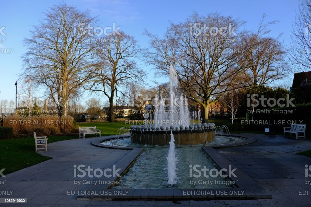 The Diamond Jubilee Fountain in Windsor, England, looking towards the River Thames (and the town of Eton beyond) in the early morning light of a December day stock photo