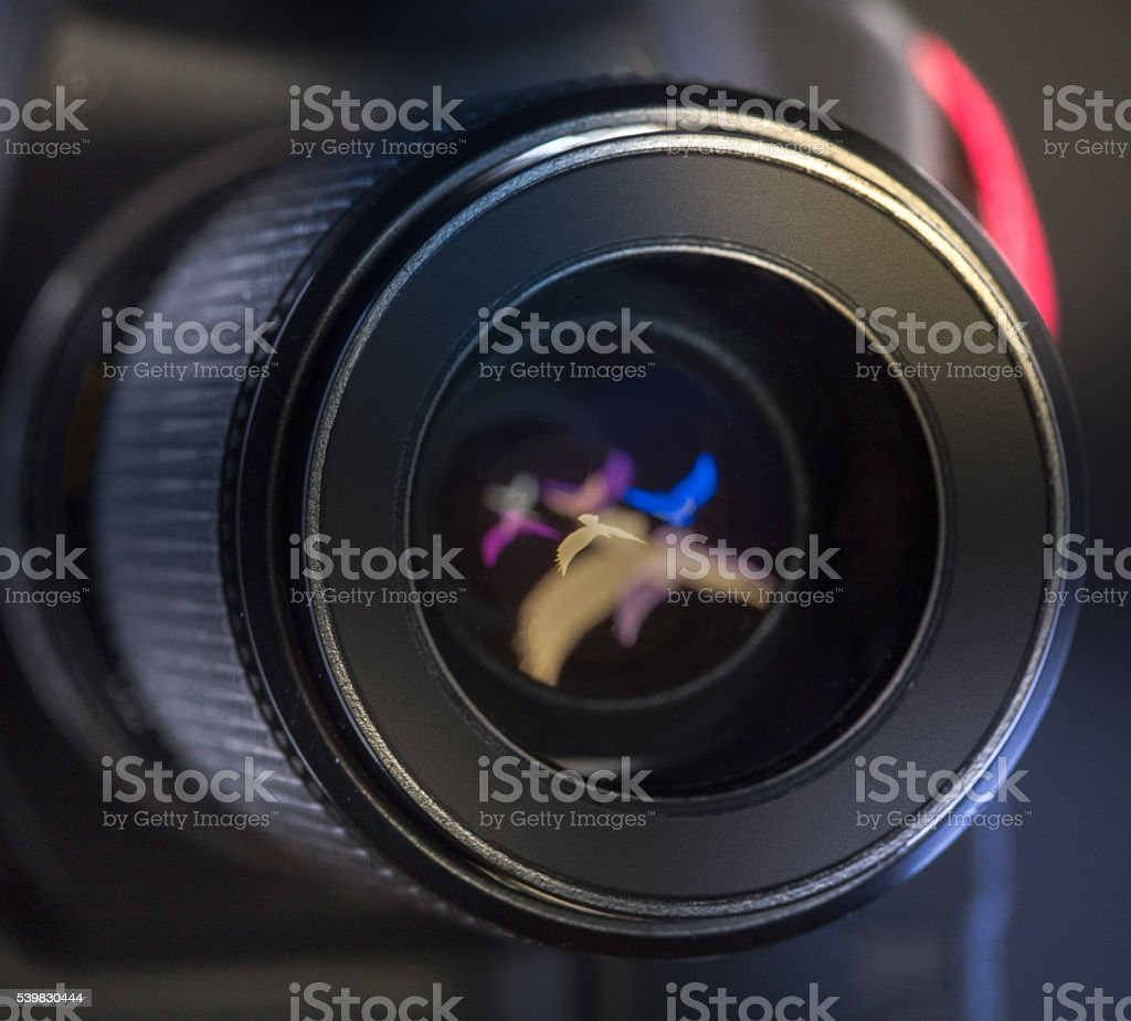 The diaphragm of a camera lens aperture. Color toned image. stock photo