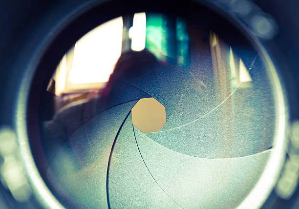 the diaphragm of a camera lens aperture. - aperture stock pictures, royalty-free photos & images