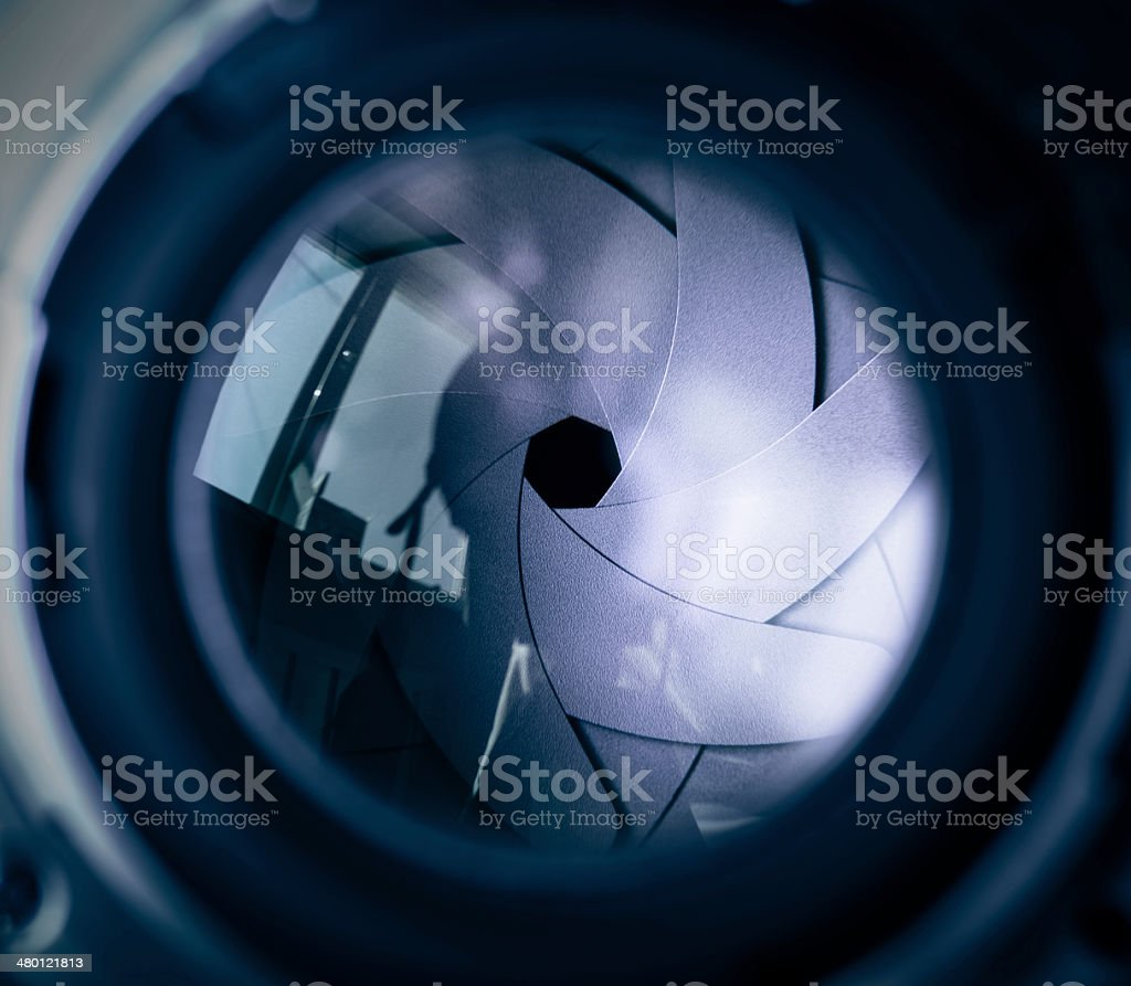 The diaphragm of a camera lens aperture. stock photo