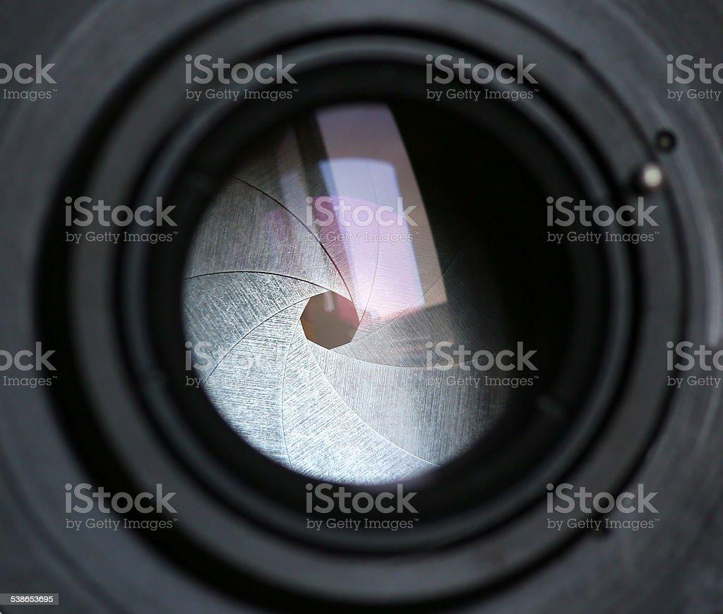 The diaphragm of a camera lens aperture stock photo