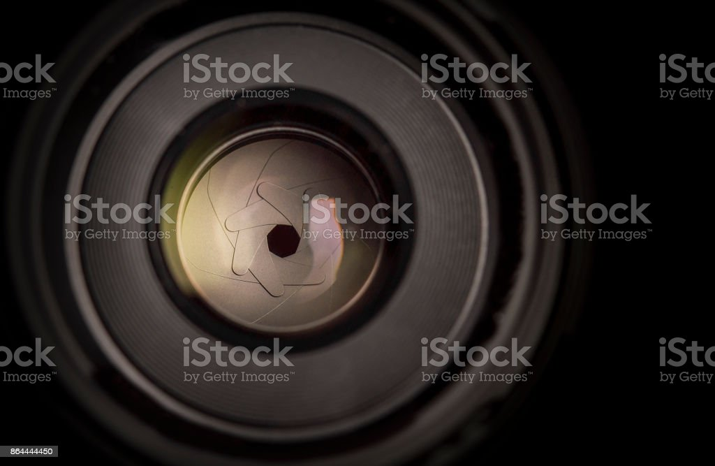 The diaphragm of a camera lens aperture. Selective focus stock photo