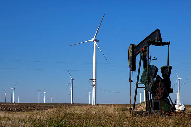 The difference between fossil fuel and clean energy stock photo