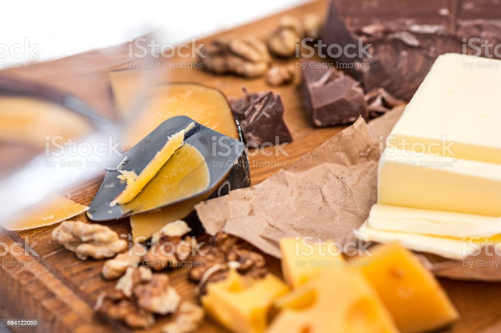 The different kind of cheese and walnuts on wooden background foto stock royalty-free