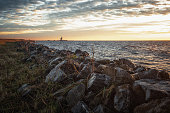 istock The dike around the island of Marken during sunrise with the lighthouse Het Paard van Marken in the background 1292428250