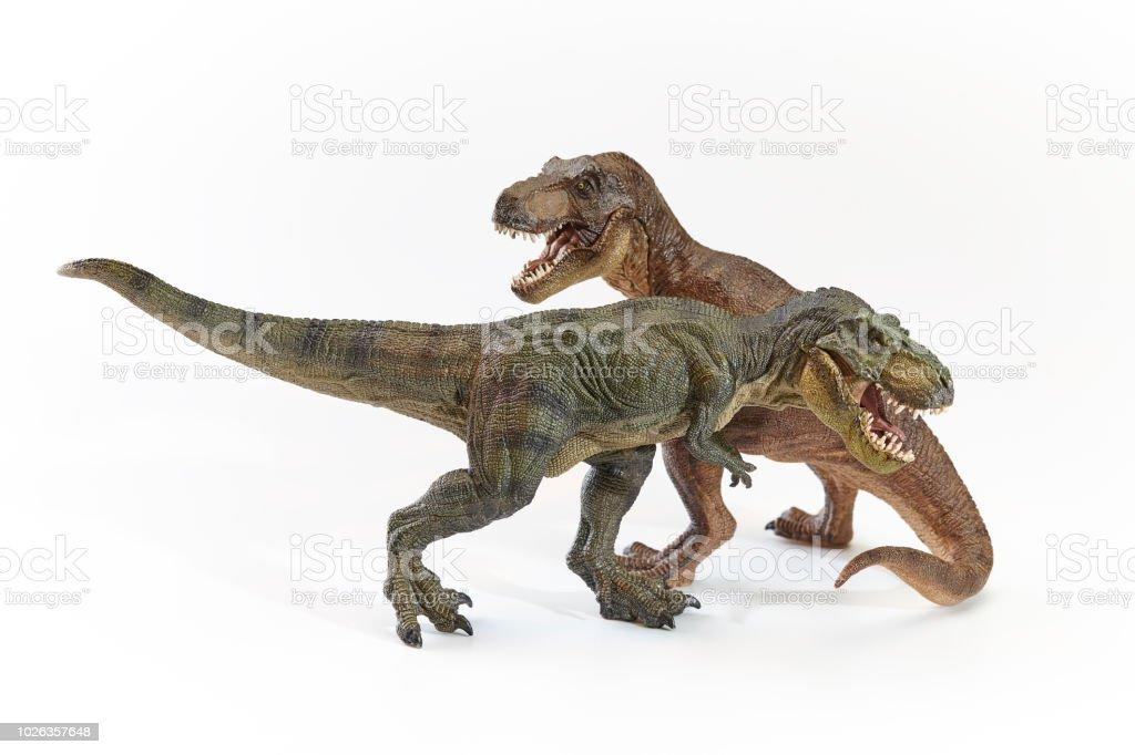 白い背景を持つアクションで恐竜ティラノサウルス おもちゃのストック