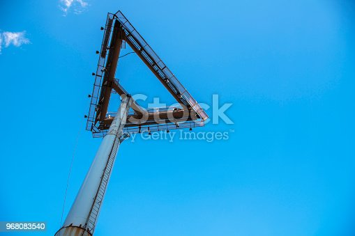 1202686823istockphoto The direction. Arrow-shaped billboard advertising strtucture 968083540