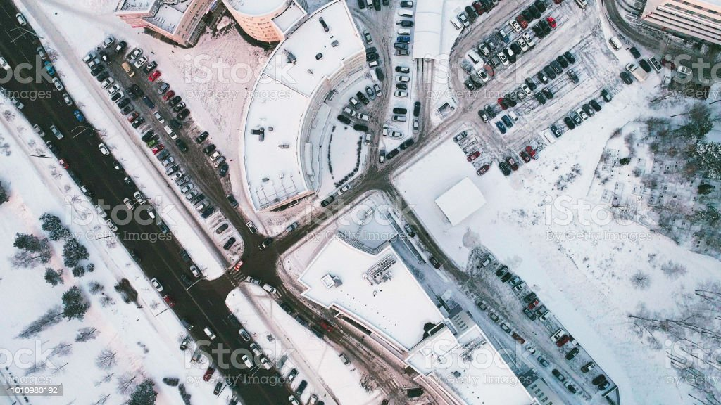 The directly above aerial drone view on the big office building with...