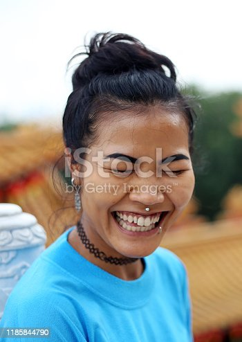 A mixed ethnicity young lady is visiting Chinese temple, Thean Hou in Kuala Lumpur Malaysia.
