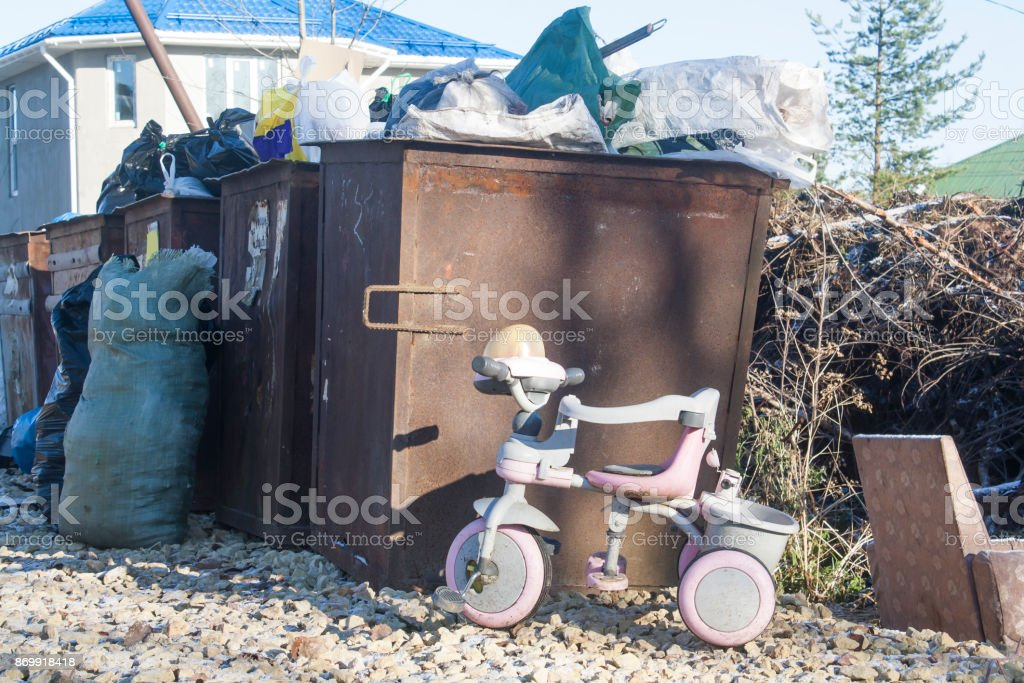 the discarded tricycle stock photo