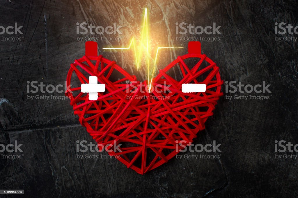 The discharge between the poles in the red heart. Charge plus and minus. Happy Valentine's Day. Love, wedding stock photo