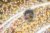 Disco ball among the decorative lights