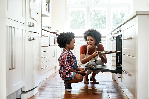 Shot of a mother and son baking together in the kitchen
