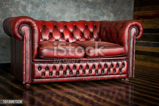 istock The divan is an honor of burgundy color in the interior 1013997026