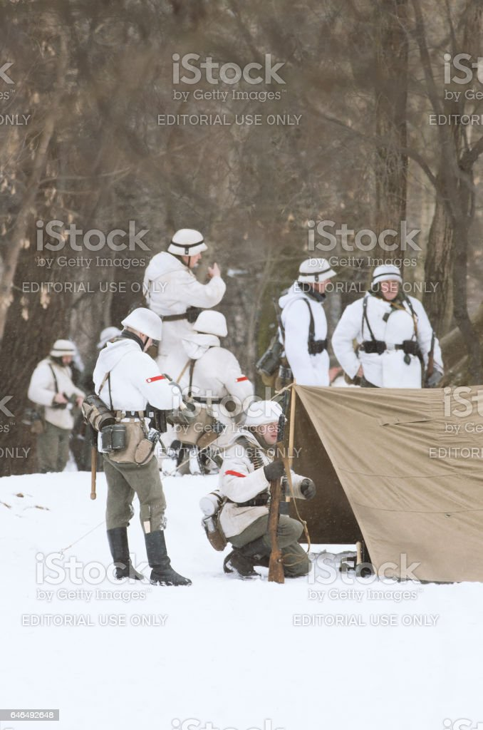 The division of the German soldiers is located on a fighting position. stock photo