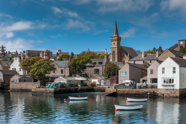 The docks and center of Stromness town. stock photo