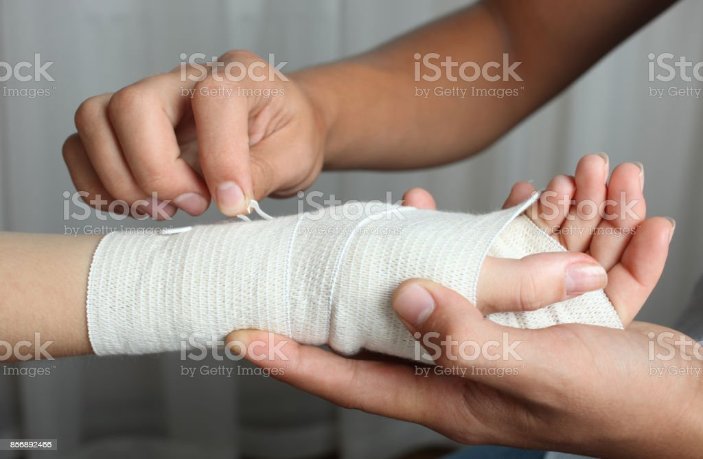 The Doctor Bandages His Hand With An Elastic Bandage Stock Photo