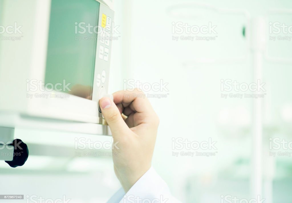 the doctor calibrates the monitor of parameters of cardiac activity and oxygenation of blood stock photo