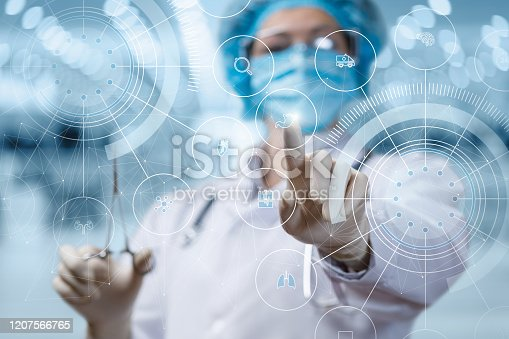 istock The doctor clicks on the stomach icon . 1207566765