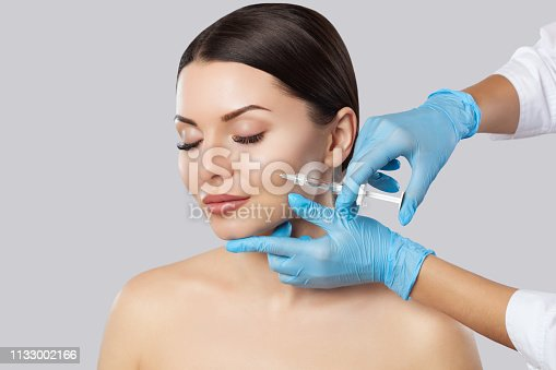 istock The doctor cosmetologist makes the Rejuvenating facial injections procedure for tightening and smoothing wrinkles on the face skin of a beautiful, young woman 1133002166
