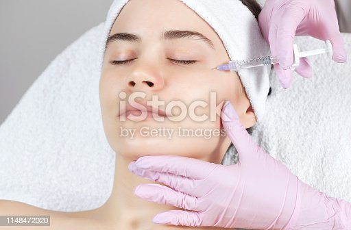 istock The doctor cosmetologist makes the Rejuvenating facial injections procedure for tightening and smoothing wrinkles 1148472020