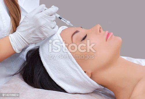 istock The doctor cosmetologist makes the Rejuvenating facial injections procedure for tightening and smoothing wrinkles on the face skin 914018624