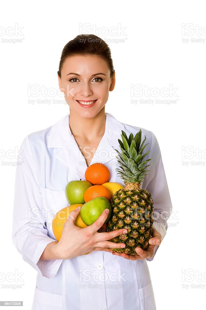 The doctor holds fruit royalty-free stock photo