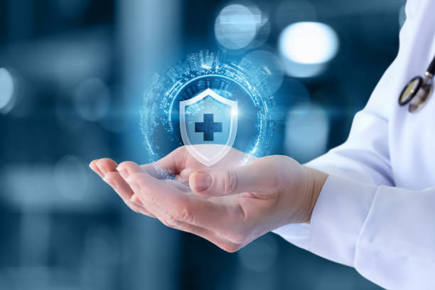 The doctor shows the icon of the protection of health . The doctor shows the icon of the protection of health on blurred background. security staff stock pictures, royalty-free photos & images