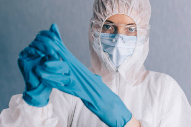 The doctor takes off his gloves. stock photo