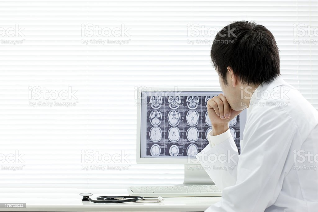 The doctor who watches an X-ray stock photo